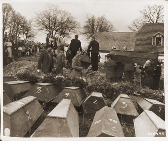 German civilians from Volary attend burial services for the Jewish women exhumed from a mass grave in the town. [LCID: 24688]