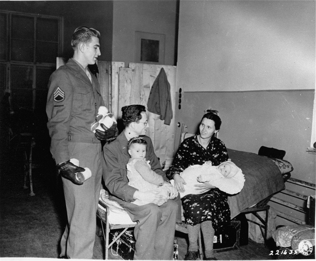 "<p>US Army and <a href=""/narrative/5002"">Joint Distribution Committee</a> (JDC) representatives distribute milk to refugees. Vienna, Austria, October 26, 1945.</p>"