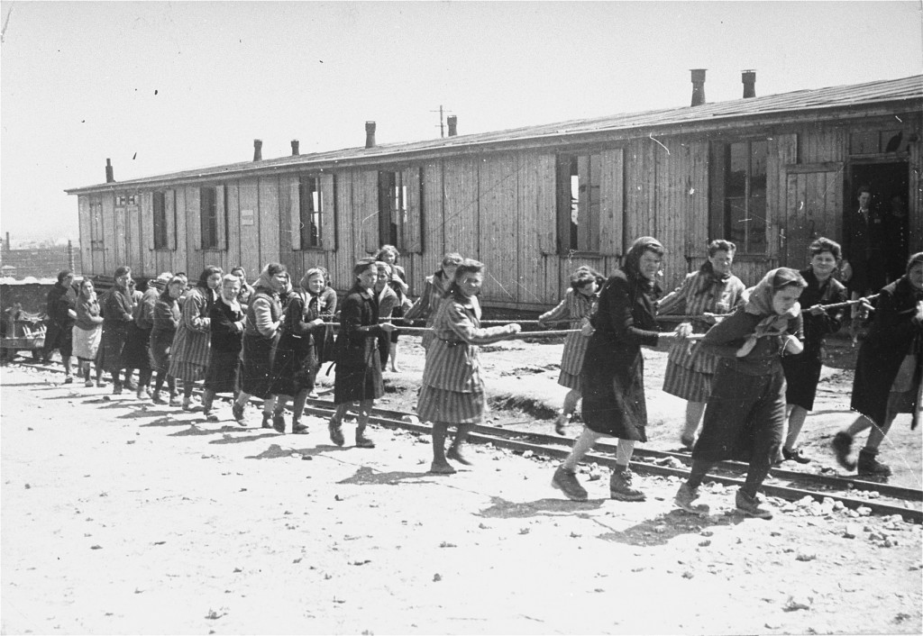 Women prisoners pull dumpcars filled with stones in the camp quarry. [LCID: 50705]