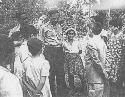 William Bein, director of the American Jewish Joint Distribution Committee (JDC) in Poland, with children at the Srodborow home for ... [LCID: 36028]