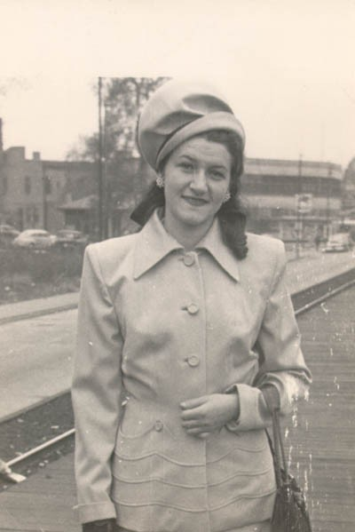 <p>Lisa wearing the first suit she bought in America (Aron recollected that it was taupe). Lisa's aunt, Faye Abrams, gave her the money to buy this suit. Photograph taken in 1947 in Chicago, Illinois, at the Illinois Central station, 75th street (Lisa was either coming or going from downtown).</p>