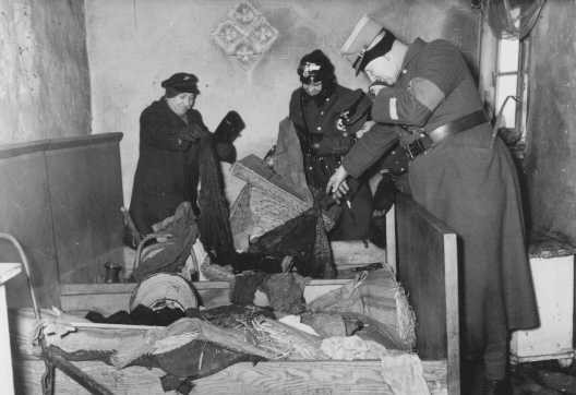 "<p>German police raid a vandalized Jewish home in the <a href=""/narrative/2152"">Lodz</a> ghetto. Lodz, Poland, ca. 1942.</p>"