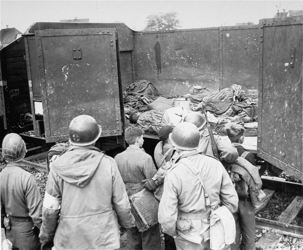 US soldiers discovered these boxcars loaded with dead prisoners outside the Dachau camp. [LCID: 0555]