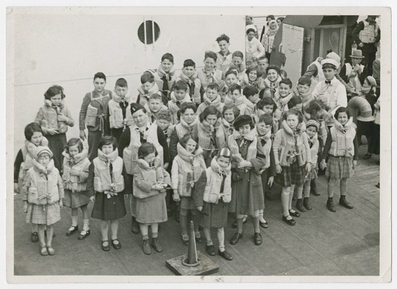 "<p>Austrian Jewish children being transported to the United States by <a href=""/narrative/11830/en"">Eleanor and Gilbert Kraus</a> perform a life jacket drill aboard the ship <em>President Harding</em>. June 1939.</p>"