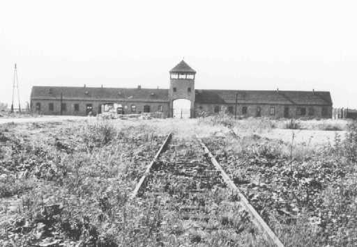 <p>Main entrance to the Auschwitz-Birkenau killing center. This photograph was taken some time after the liberation of the camp in January 1945. Poland, date uncertain.</p>