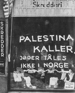 "<p>On a Jewish-owned shop, Norwegian fascists painted the slogan: ""Palestine is calling. Jews are not tolerated in Norway."" Norway, after April 1940.</p>"