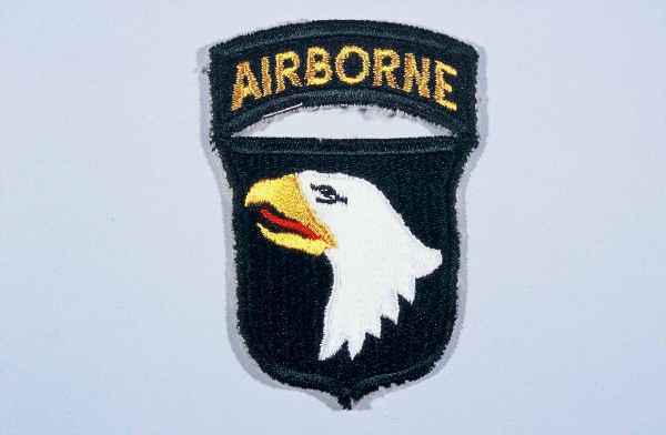 """Insignia of the 101st Airborne Division. The nickname of the 101st Airborne Division, """"Screaming Eagles,"""" originates from the division's ... [LCID: n05652]"""