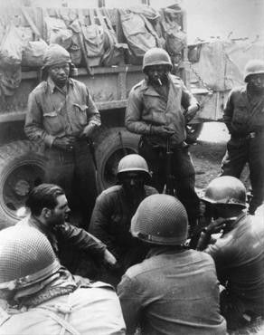 Members of the 12th Armored Division, which included African American platoons, await their orders. [LCID: 83791]