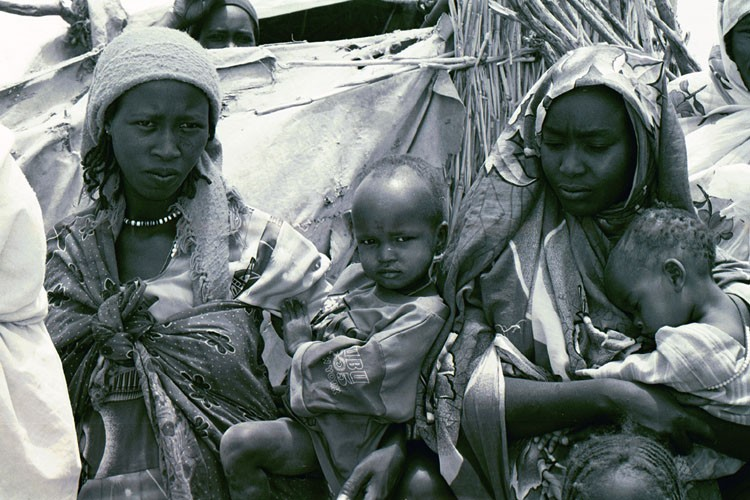 <p>Refugees in a camp in eastern Chad for refugees from the Darfur region of neighboring Sudan. Jerry Fowler, Staff Director of the Museum's Committee on Conscience, visited in May 2004 to hear firsthand the refugees' accounts of the genocidal violence they faced and of being driven into the desert.</p>