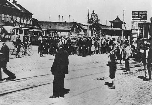 Jewish residents of the Szeged ghetto assemble for deportation. [LCID: 37207]