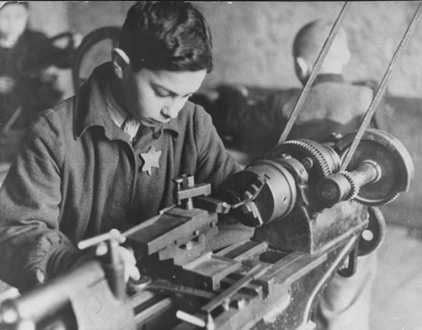 Child forced laborer in a ghetto factory. Kovno, Lithuania, between 1941 and 1944. [LCID: 81181]