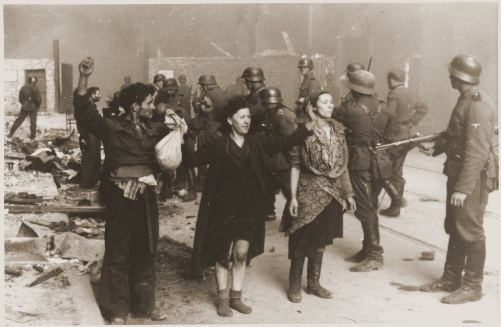 Jewish resistance fighters captured by SS troops during the Warsaw ghetto uprising. [LCID: 46193]