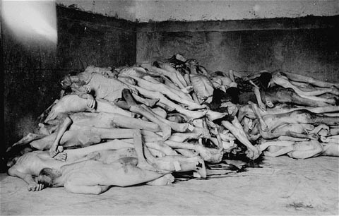 The bodies of former prisoners are piled in the crematorium mortuary in the newly liberated Dachau concentration camp. [LCID: 06112]