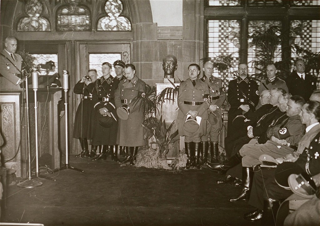 <p>Nazi officials and Catholic bishops listen to a speech by Wilhelm Frick, Reich Minister of the Interior, at an official ceremony in the Saarbrucken city hall marking the reincorporation of the Saarland into the German Reich. March 1, 1935.</p> <p>Among those pictured is Joseph Goebbels (seated at the far right), Franz Rudolf Bornewasser (Bishop of Trier) and Ludwig Sebastian (Bishop of Speyer).</p>