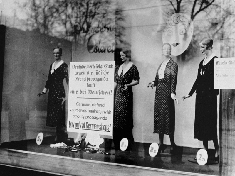 "<p>A <a href=""/narrative/102"">boycott</a> sign posted on the display window of a Jewish-owned business reads: ""Germans defend yourselves against Jewish atrocity propaganda. Buy only at German shops!"" Berlin, Germany, April 1, 1933.</p>"