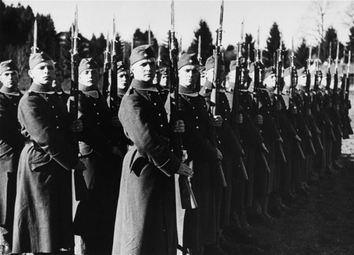 "<p><a href=""/narrative/10800"">SS troops</a> stand at attention for inspection, Germany, 1936-1939. This photo is from an album of SS photographs. </p>"
