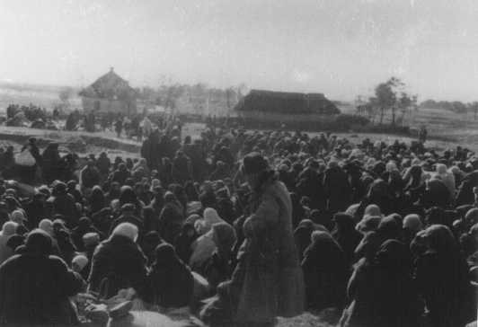 "<p>Over one thousand Jews from the Ukrainian town of Lubny, ordered to assemble for ""resettlement,"" in an open field before they were massacred by Einsatzgruppen. Lubny, Soviet Union, October 16, 1941.</p>"