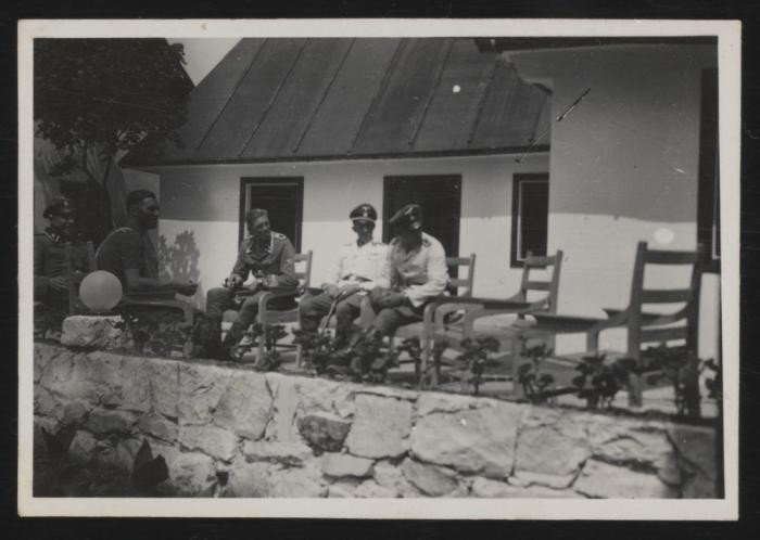 "<p><span style=""font-weight: 400;"">Members of the <a href=""/narrative/10800"">SS</a> sitting on the terrace of the new officers' dining room (known as the ""Kasino"") in <a href=""/narrative/3790"">Sobibor</a>, early summer 1943. From left to right: Hubert Gomerski, Erich Schulze, Gustav Wagner, deputy camp commandant Johann Niemann, and an unidentified man.</span></p>