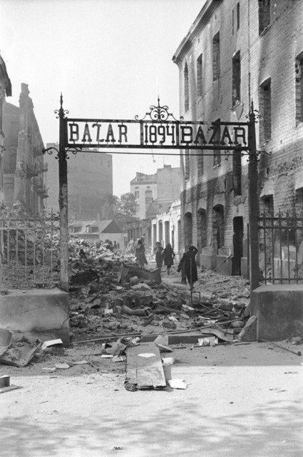 View of the entrance to a marketplace reduced to rubble as a result of a German aerial attack. [LCID: 64525]