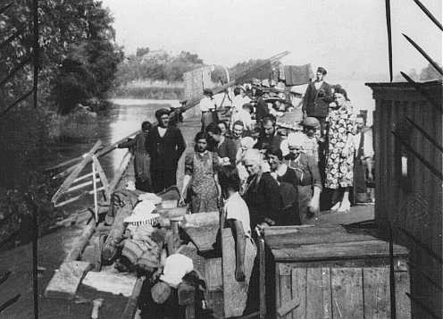 Stateless European Jews, expelled from their homes, live on a barge on the Danube River.
