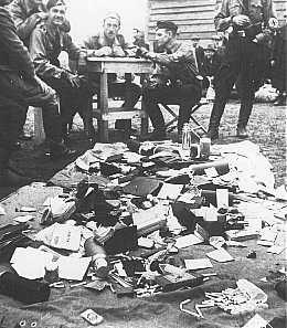Ustasa (Croatian fascist) guards alongside belongings of prisoners at the Jasenovac concentration camp.