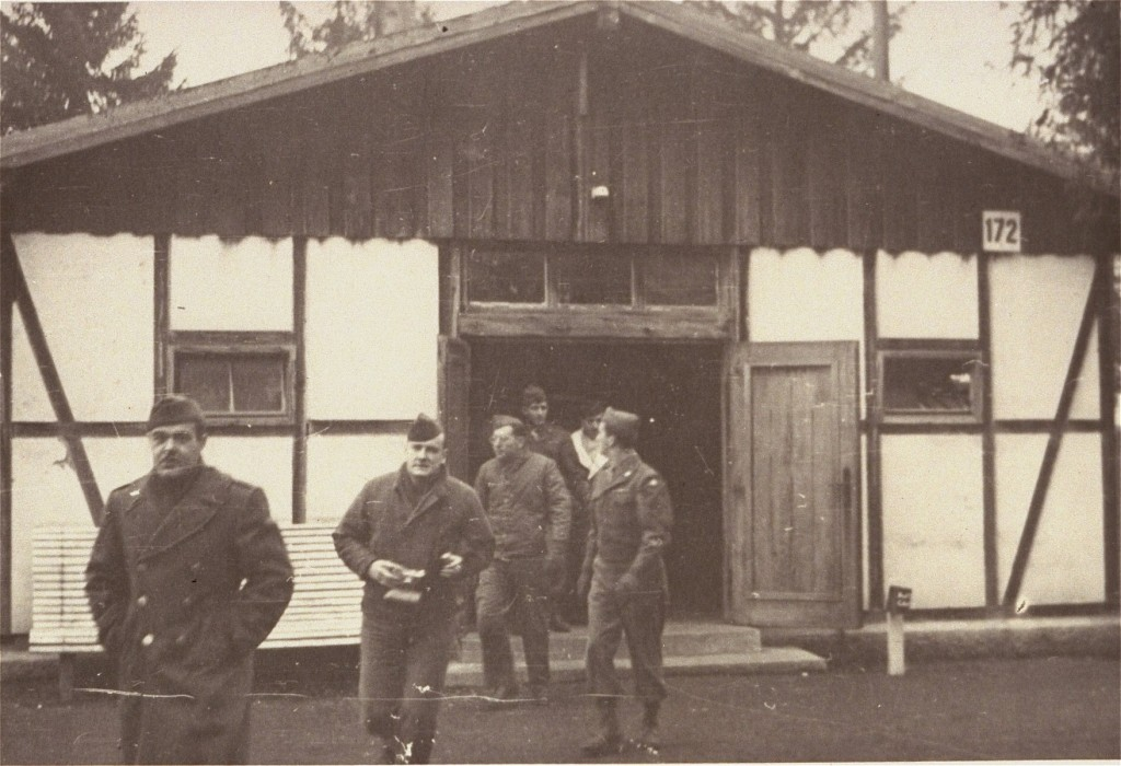 American soldiers finish their inspection of Dachau's first crematorium. [LCID: 02068]