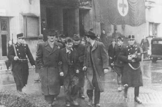 <p>Members of the fascist Arrow Cross Party arrest Jews. Budapest, Hungary, October-December 1944.</p>