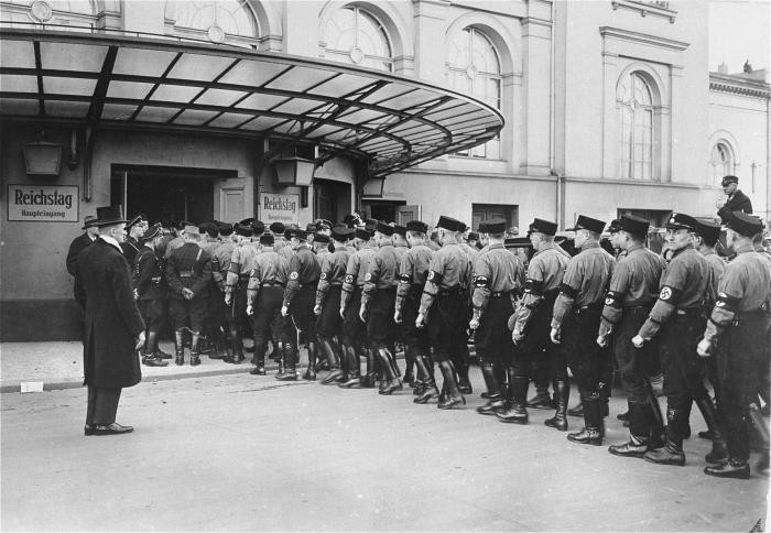 SS detachment files into Kroll Opera House for opening of a Reichstag