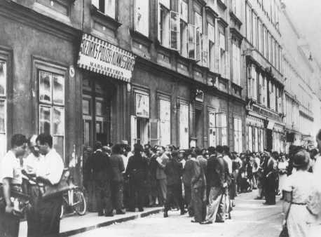 <p>Jews wait in line at the Margarethen police station for exit visas after Germany's annexation of Austria (the Anschluss). Vienna, Austria, March 1938.</p>