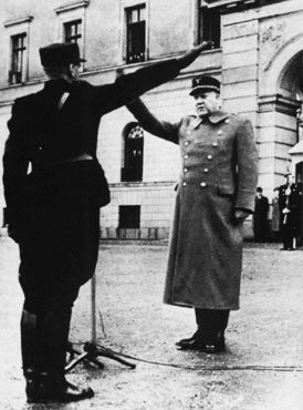 <p>Vidkun Quisling, leader of the collaborationist Norwegian government, returns a salute during a ceremony in Oslo. Norway, after April 1940.</p>
