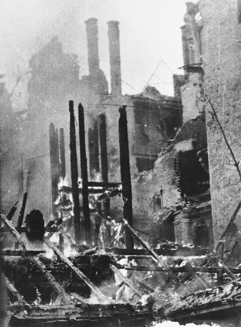View of the smoldering ruins of a building in Warsaw following a German aerial attack. [LCID: 64518]