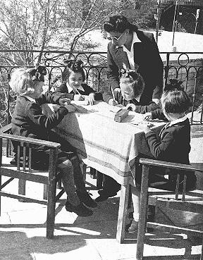 "<p>Some of the Polish Jewish refugee children known as the ""Tehran Children"" with an instructor after their arrival in Palestine. Atlit, Palestine, 1943.</p>"