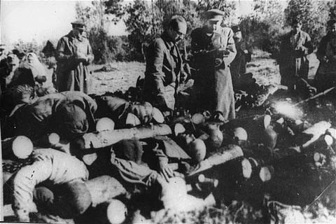 "<p>Soviet officials view stacked corpses of victims at the Klooga camp. Due to the rapid advance of Soviet forces, the Germans did not have time to burn the corpses. Klooga, <a href=""/narrative/5858/en"">Estonia</a>, 1944.</p>"