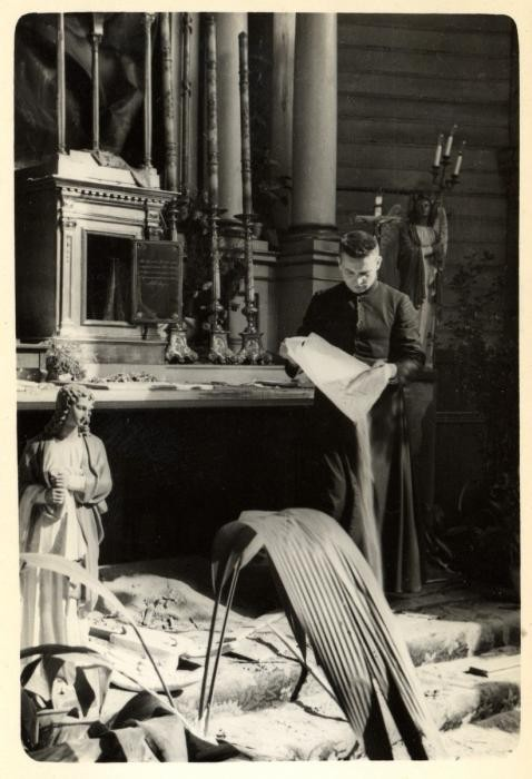 <p>Father Wlodarczyk attempts to clean and repair a bombed-out church in the besieged city of Warsaw. Photographed by Julien Bryan, Warsaw, Poland, ca. 1939.</p>
