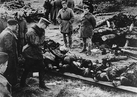 At the Klooga concentration camp, Soviet soldiers examine the bodies of victims left by the retreating Germans. [LCID: 87679]