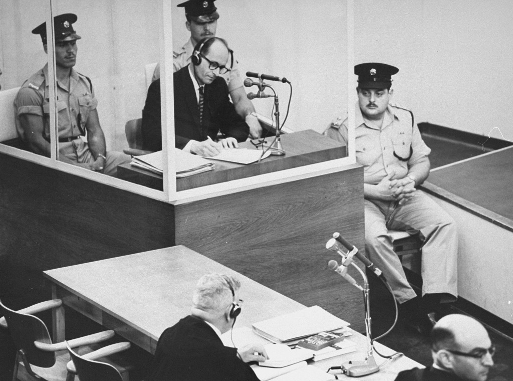 Defendant Adolf Eichmann takes notes during his trial in Jerusalem in 1961. [LCID: 65268]