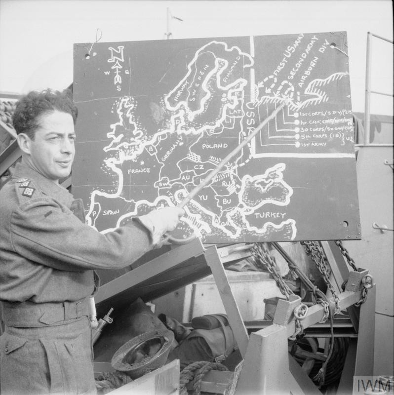 "<p>Captain Lasdun briefs troops of the British Army on June 4, 1944, two days before the Allied invasion of Normandy on <a href=""/narrative/2899"">D-Day</a>.</p>"