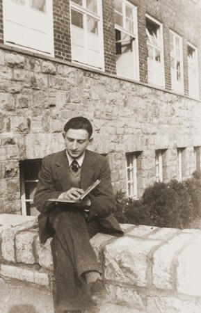 "<p>Gerd Zwienicki studies outside the Würzburg Jewish teachers seminary shortly before it was closed down on <a href=""/narrative/4063"">Kristallnacht</a>. Würzburg, Germany, 1938.</p>"