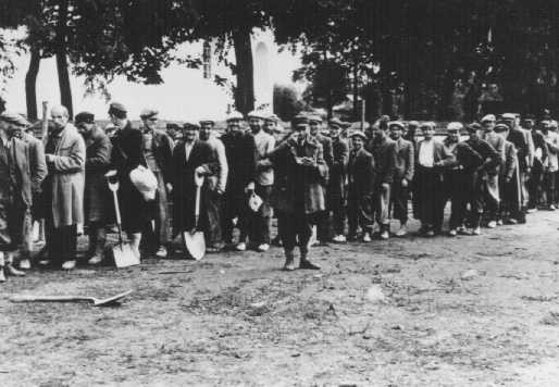 <p>A group of Poles assembled for forced labor. Poland, June 30, 1943.</p>