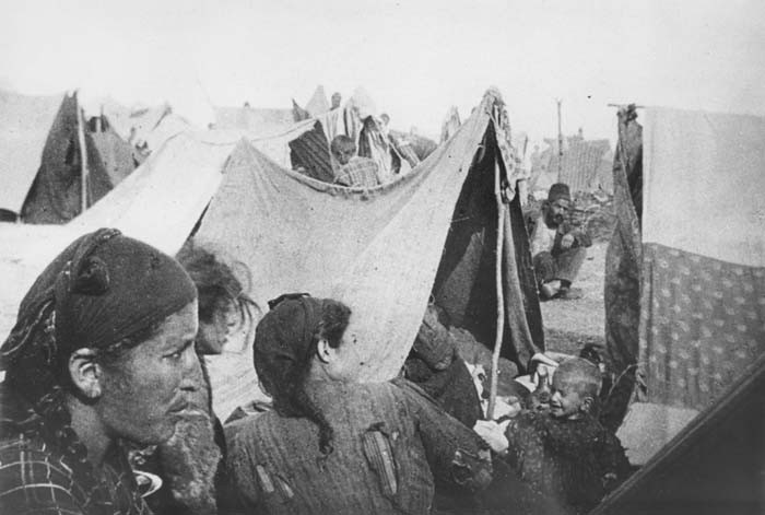 <p>Armenian families next to makeshift tents in a refugee camp. Ottoman Empire, 1915-16.Photograph taken by Armin T. Wegner. Wegner served as a nurse with the German Sanitary Corps. In 1915 and 1916, Wegner traveled throughout the Ottoman Empire and documented atrocities carried out against the Armenians. [Courtesy of Sybil Stevens (daughter of Armin T. Wegner). Wegner Collection, Deutsches Literaturarchiv, Marbach & United States Holocaust Memorial Museum.]</p>