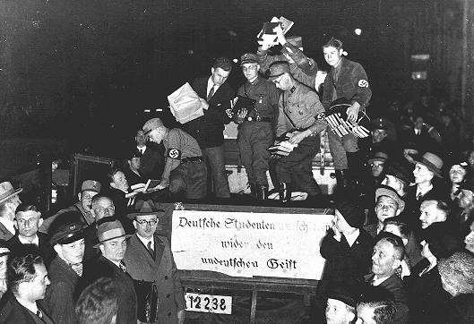 "Students and members of the SA unload books deemed ""un-German"" during the book burning in Berlin. [LCID: 45032]"