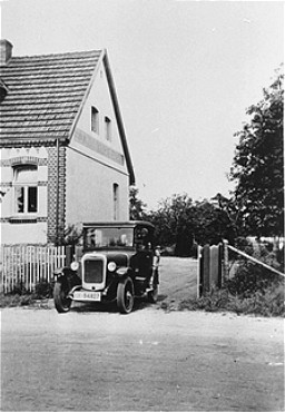 "<p>The Kusserow family home in Bad Lippspringe. The family, <a href=""/narrative/5070"">Jehovah's Witnesses</a>, kept religious materials in the trunk of the car and distributed them from it as well. The Kusserow family was active in their region distributing religious literature and teaching Bible study classes in their home. Their house was conveniently situated for fellow Witnesses along the tram route connecting the cities of Paderborn and Detmold. For the first three years after the <a href=""/narrative/65"">Nazis came to power</a>, the Kusserows endured moderate persecution by local Gestapo agents, who often came to search their home for religious materials. In 1936, Nazi police pressure increased dramatically, eventually resulting in the arrest of the family and its members' internment in various concentration camps. Most of the family remained incarcerated until the end of the war. Bad Lippspringe, Germany, 1933-1937.</p>"