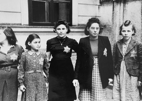 Jewish women and girls wearing the compulsory yellow badge. [LCID: 78590]