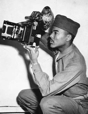 "<p>African Americans were among the liberators of the <a href=""/narrative/3956/en"">Buchenwald</a> concentration camp. William Scott, seen here during training, was a military photographer and helped document Nazi crimes in the camp. Alabama, United States, March 1943.</p>"
