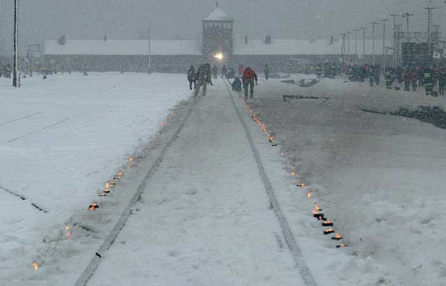 "<p>Candles mark the railway tracks leading to the <a href=""/narrative/3673"">Auschwitz</a> camp during the commemoration of the 60th anniversary of the <a href=""/narrative/2317"">liberation</a> of the camp. Poland, January 27, 2005.</p>"