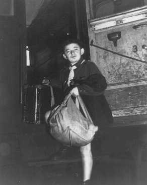 <p>A Jewish refugee child steps off a train in Czechoslovakia. He is one of 510 Polish orphans on their way to homes in France and Belgium as part of a program worked out by UNRAA. Dablice, Czechoslovakia, 1946.</p>