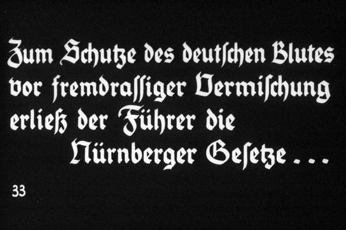 "33rd Nazi propaganda slide of a Hitler Youth educational presentation entitled ""Germany Overcomes Jewry."" [LCID: 93592]"
