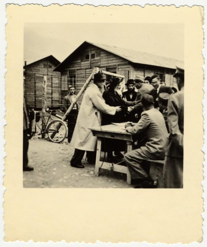George Mandel-Mantello greats the Satmar Rebbe, Joel Teitelbaum, when his arrival in Switzerland on the Kasztner transport from Bergen-Belsen. [LCID: 44707]