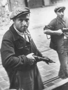 <p>Bedukian Sarkis, a French partisan of Armenian extraction, patrols a street along with another partisan during the August 1944 insurrection in the south of France. Marseille, France, August 1944.</p>