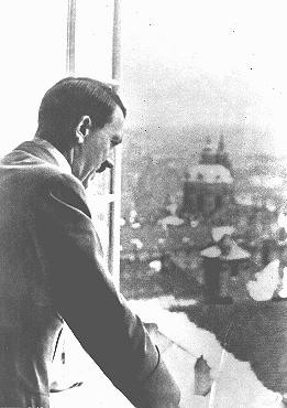 Adolf Hitler looking out at occupied Prague from the Hradcany Castle.